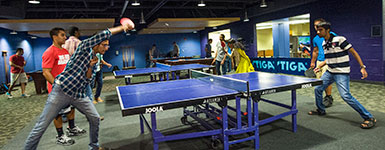 photo of students playing ping pong