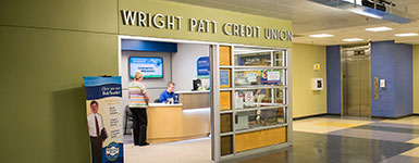photo of a customer and employee in the wright patt credit union