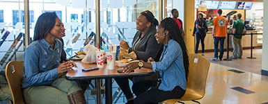 photo of students sitting at a table in the student union