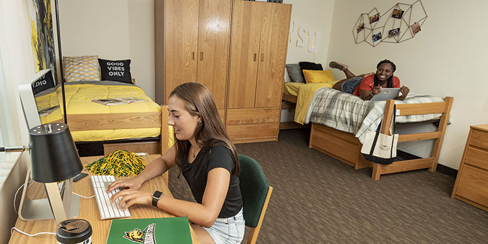 photo of two students in a dorm room in The Woods