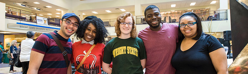 photo of students standing in the student union atrium