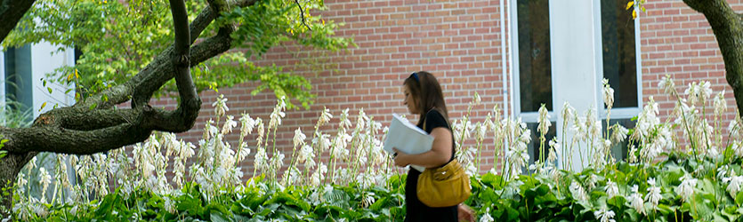 photo of a staff member walking on campus