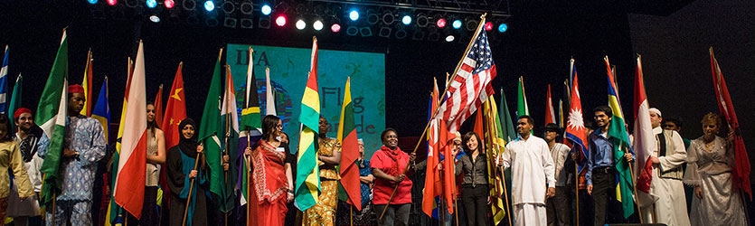 photo of people on stage at the international friendship affair