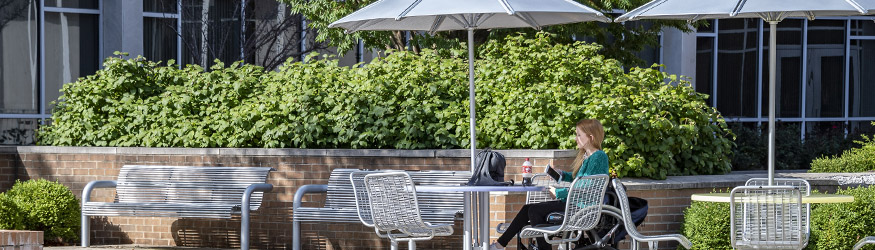 photo of a student sitting outside on campus