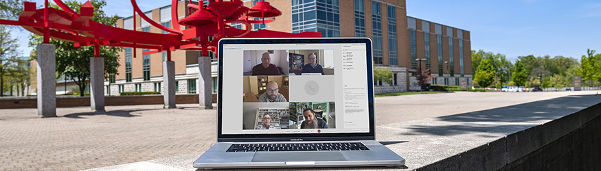 photo of a laptop with a webex meeting on the screen