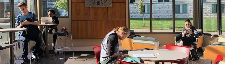 photo of students in reyrey cafe using devices