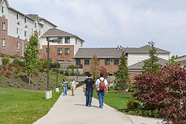 Picture of students walking around honors community