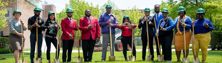 Photo of NPHC students and President Edwards at NPHC plot groundbreaking