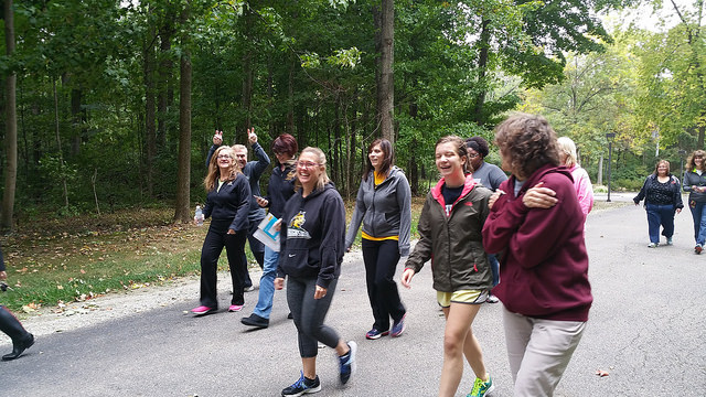 Staff walking near the woods