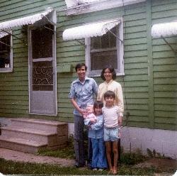 Family outside of house