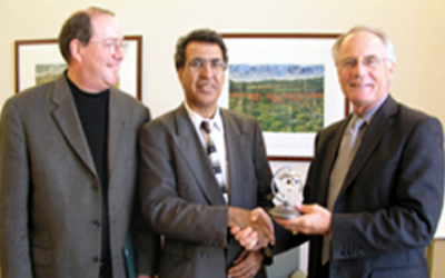 Fall Ainina, Professor and Chair of the Department of Finance and Financial Services with Provost David Hopkins, right, and Doug