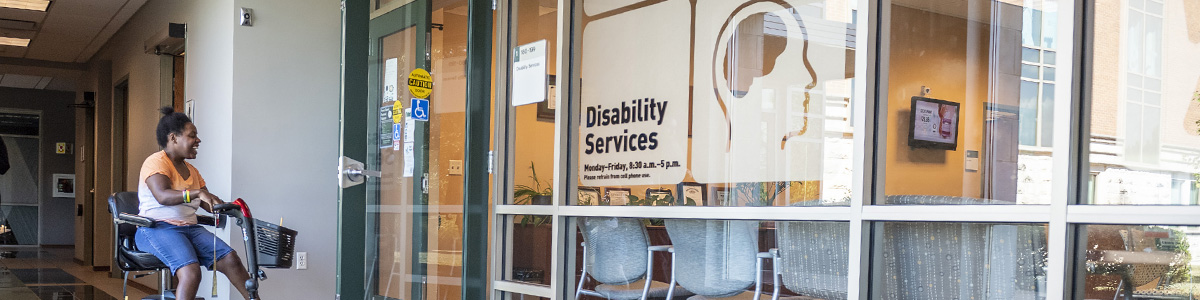 photo of a student entering the office of disability services
