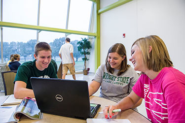 photo of lake campus students looking at a laptop