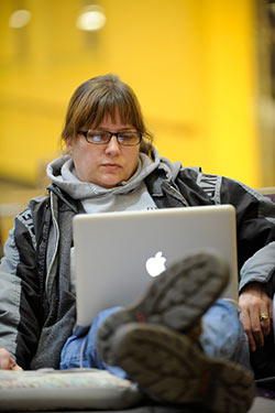 photo of a person looking at a laptop