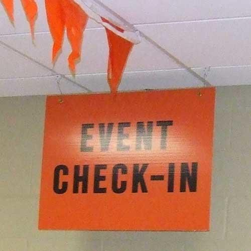 Orange Career Center event check-in sign and orange flags