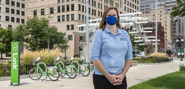 Master of Public Health, Woman in mask standing in city