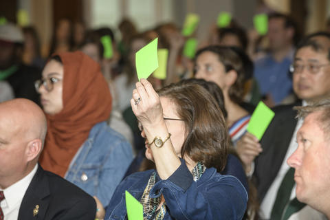 Participants vote at a planning summit.