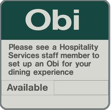 Example sign reads Obi. Please see a hospitality services staff member to set up an Obi for your dining experience. Below the words available and in use with a slider that can be changed to indicate the status.