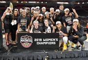Women pose as champions