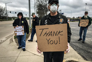 Men holding thank you signs