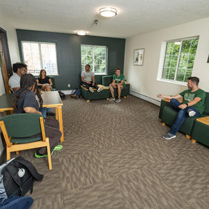 photo of students in a dorm lounge