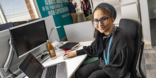 student working at her computer