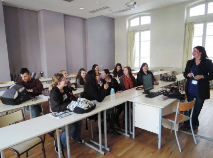 Students in a classroom with USAC visiting professor